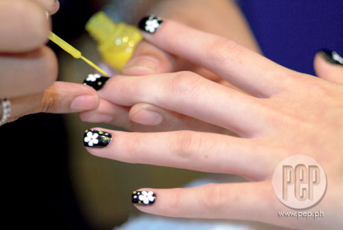 Shainas nail art pep shainas nails were first painted black which served as base floral stickers were then applied as a finishing touch the nails were dotted in various prinsesfo Images