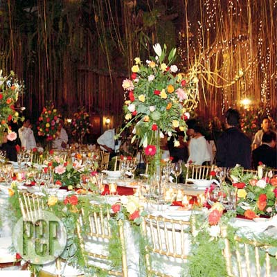 At Fernwood Gardens Project 6 Quezon City During The Garden Reception For Gladys Reyes And Christopher Roxas Tables Were Festooned With Centerpiece