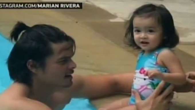 Baby Zia enjoys first swimming lessons with Daddy Dingdong