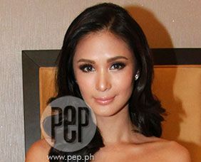 Heart Evangelista hesitant at first to pose for rhum brand's 2014 cale