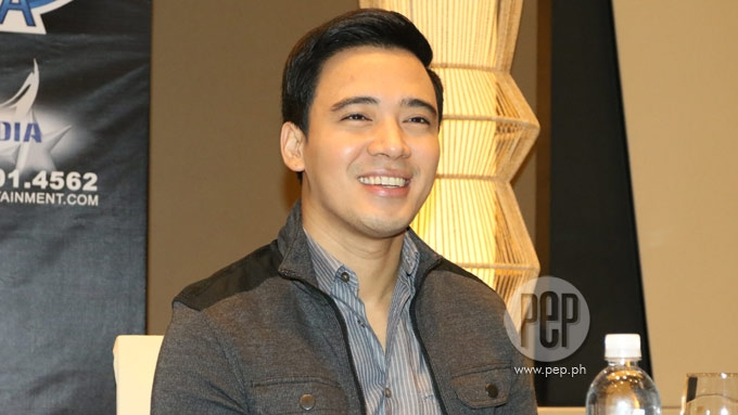 How does Erik Santos feel performing with OPM greats?