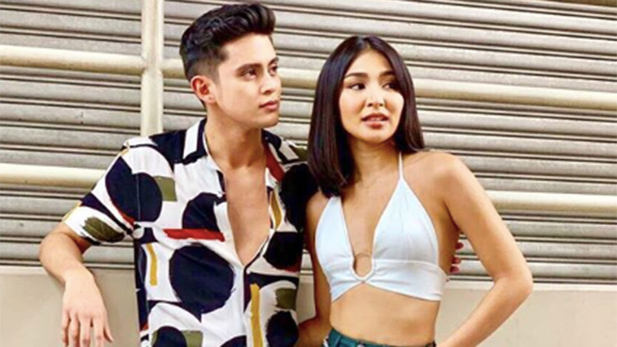 James Reid admits living in with Nadine Lustre