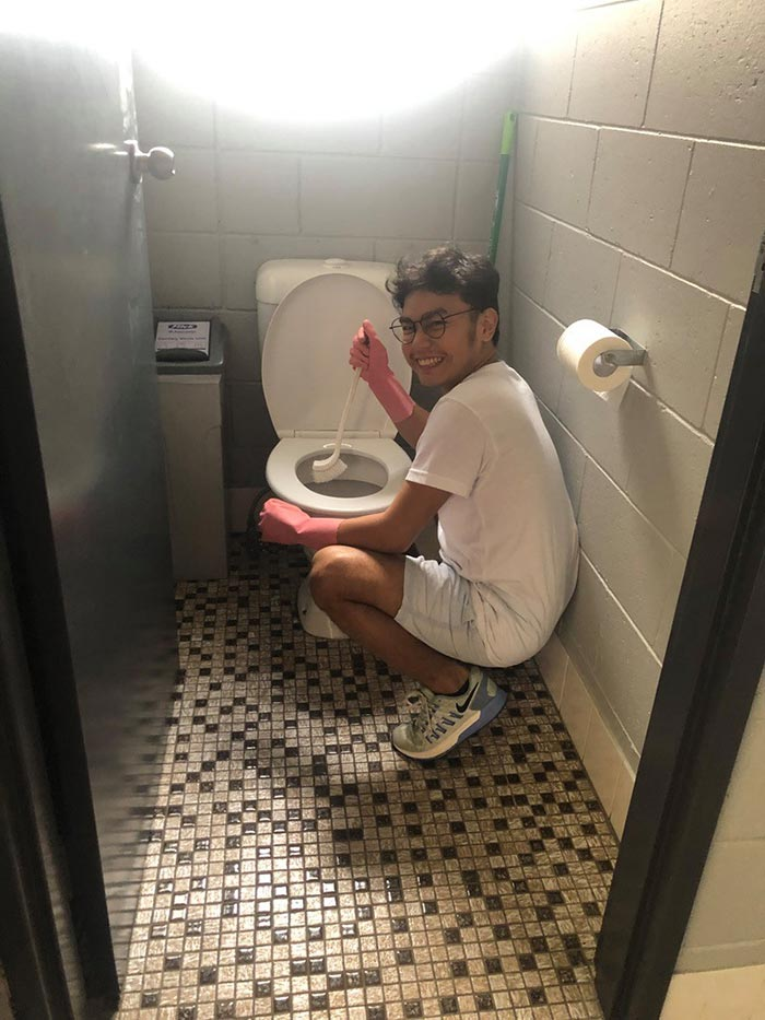 Jao cleaning the toilet of a public comfort room