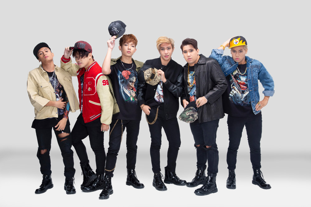 1ST.ONE members: (standing) J, Ace, Joker, (seated) Alpha, Jayson, and Max