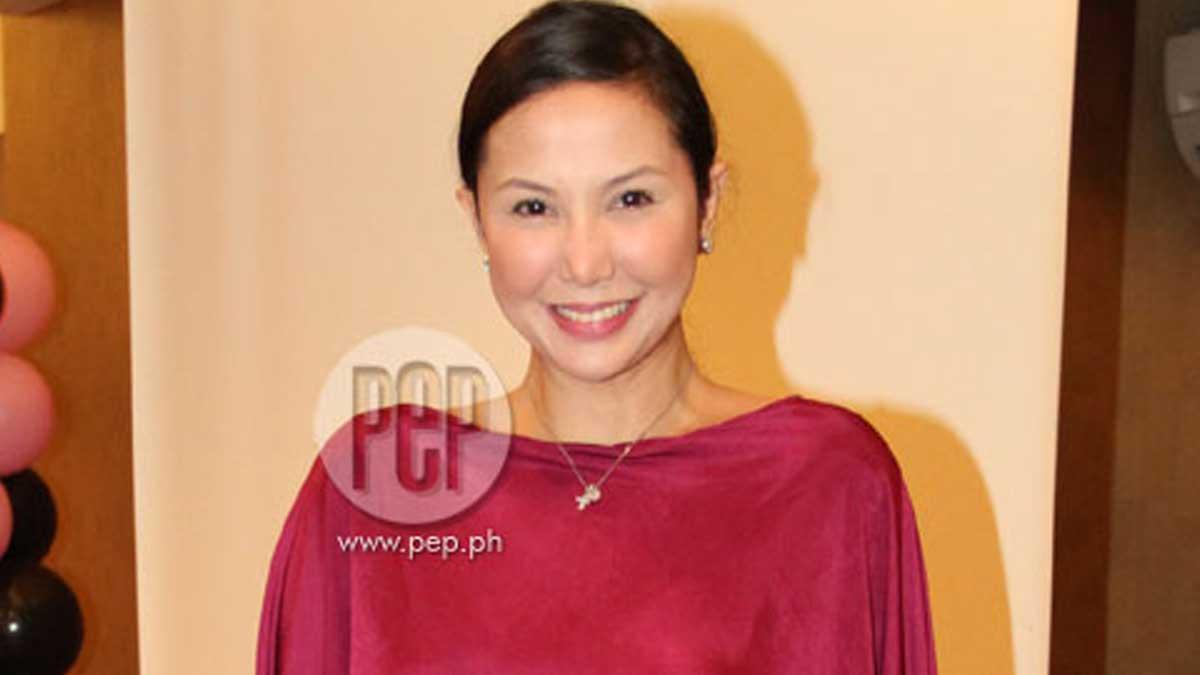 Maureen Larrazabal in red blouse.