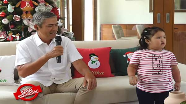 Vic Sotto with daughter Tali in an episode of Eat Bulaga, where Vic reports from home.