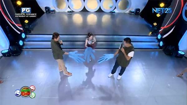 Janno, Kitkat, and Anjo play the game Maalis Taya.