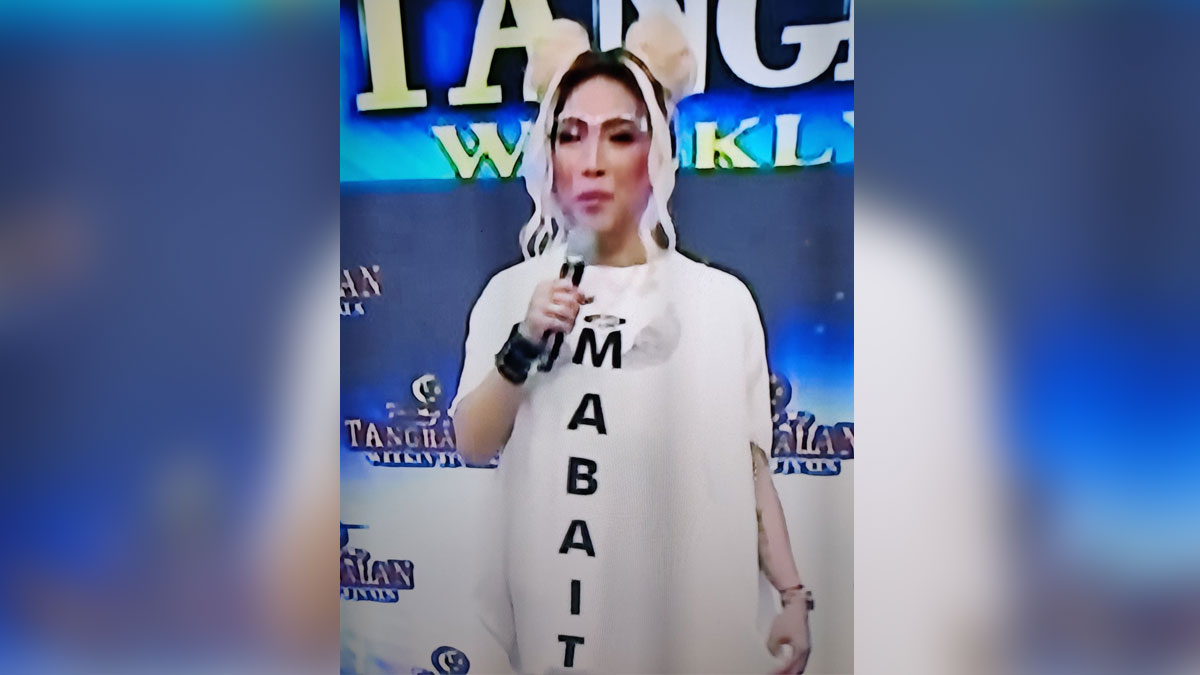Vice Ganda in white long dress with MABAIT printed on it.