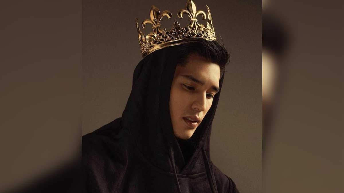 Gab Lagman wearing a hoodie and a crown.