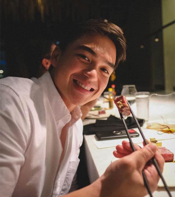 instagram: dominic roque holding chopsticks