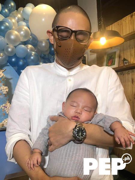 Miguel Antonio Cruz carrying baby night