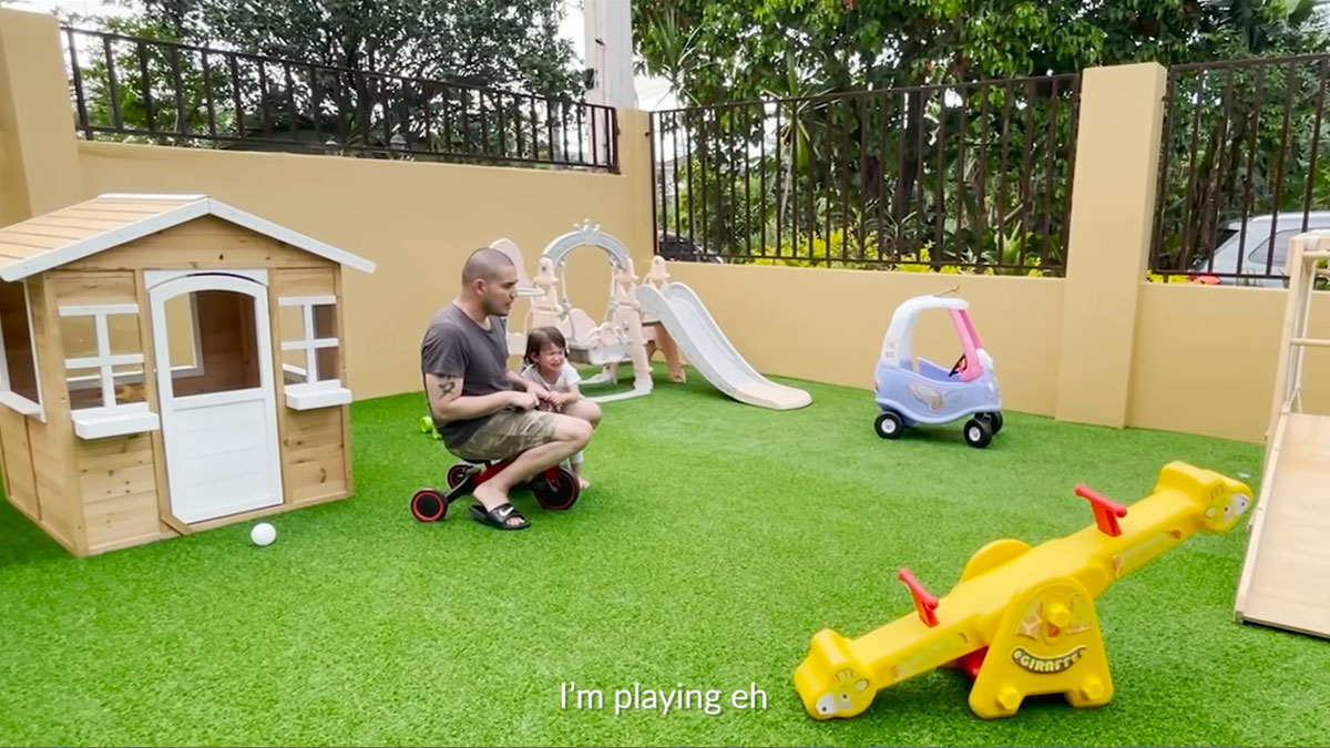 paolo contis with daughter in their backyard playground