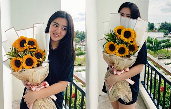 Cassy Legaspi with bouquet of sunflowers