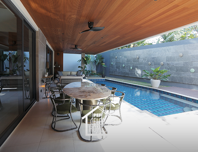 Derek Ramsay House furniture: pool area with Patagonia marble table