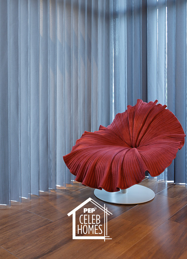 Derek Ramsay House furniture: muted red Bloom swivel chair