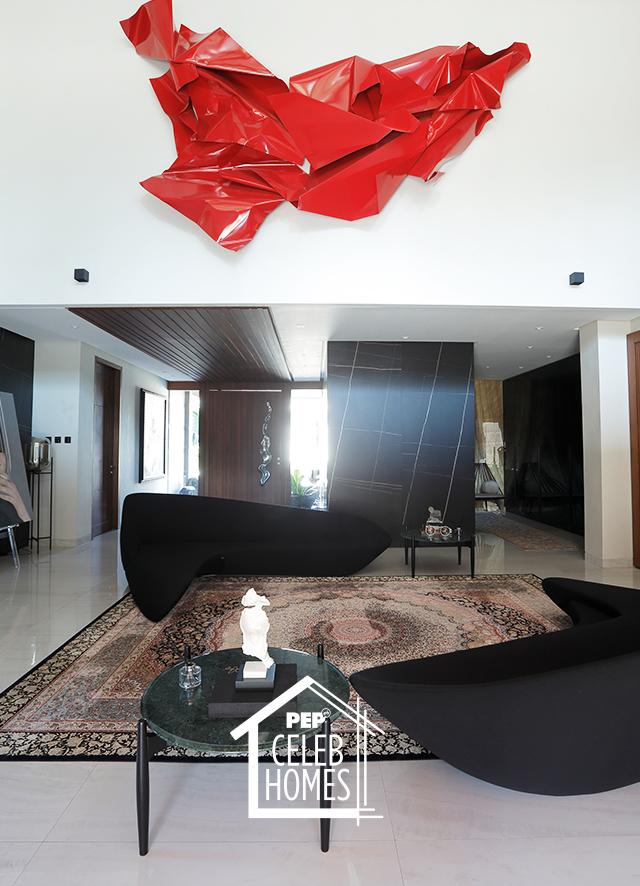 Derek Ramsay House furniture: boomerang-shaped sofas