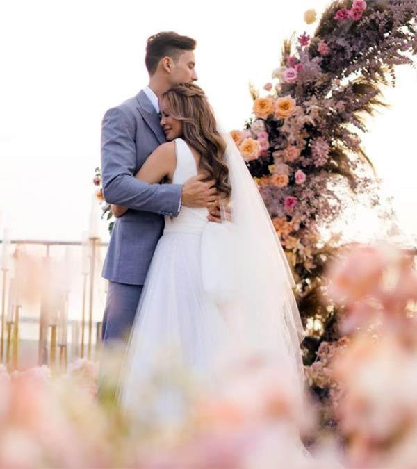 Newly weds Sam Pinto, Anthony Semerad hugging