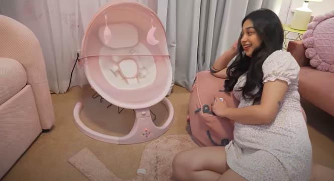 Youtube Vlog: Zeinab beside electric baby cradle