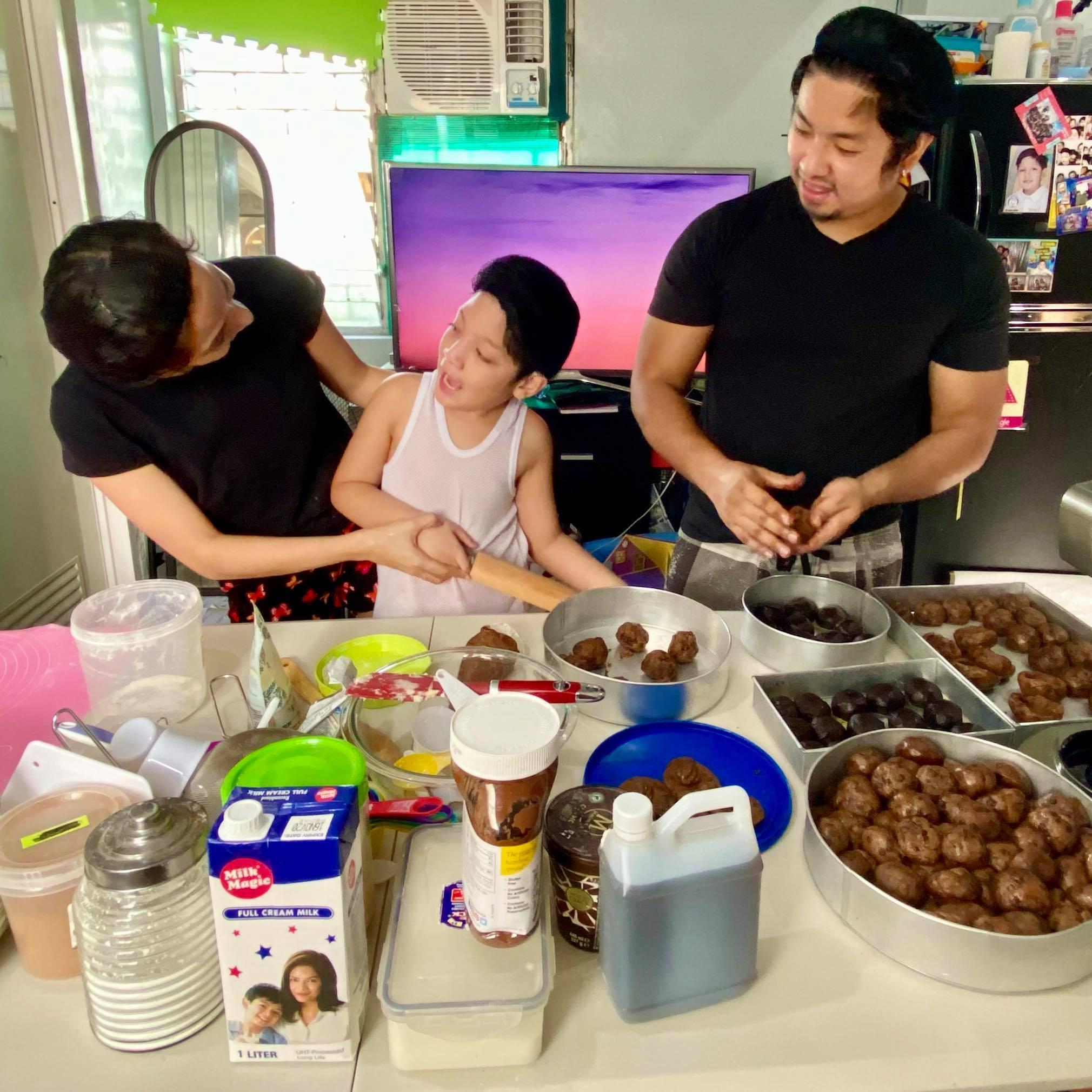 Ella Infante, husband Deen Opella, son Matteo baking