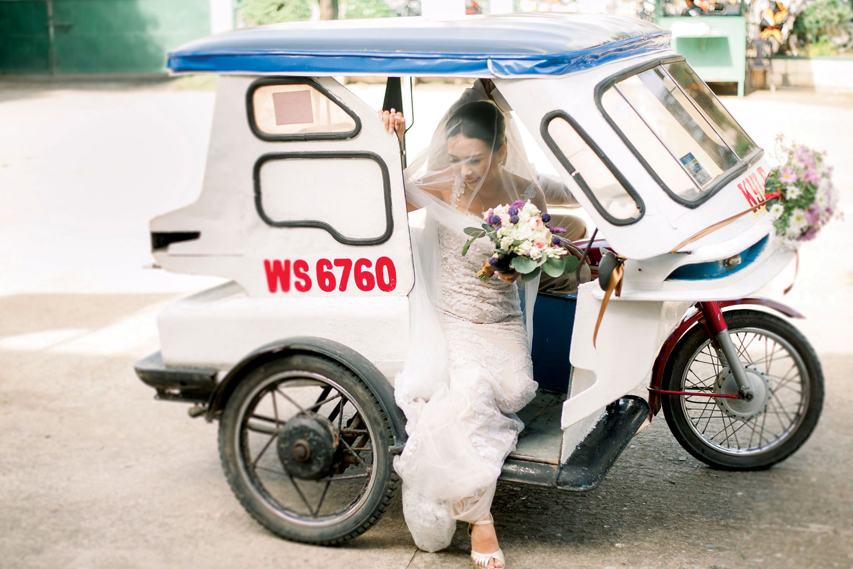 Bride Tita Kim riding tricycle