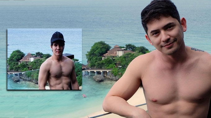 Who is Ahron Villena's hunky travel companion?