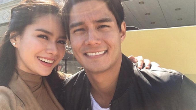 Daniel kisses Erich on the forehead during a show abroad