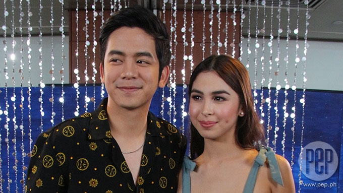 Joshua blushes after Julia's revelation that she likes him
