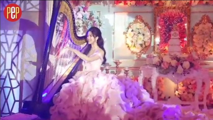 Watch Kisses Delavin play the harp at her debut party