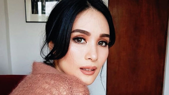 Heart Evangelista holds back tears as she answers a question
