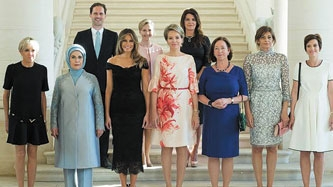 Luxembourg's gay first husband joins wives of world leaders for photo op