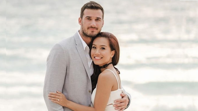 Rachelle Ann Go wears a bridal dress designed by her brother